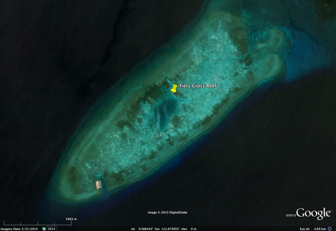 FieryCrossReef, May 31, 2014. Note the only man-made structure (small platform) at the bottom left of island. Light green and blue areas are coral reef habitat.