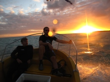 Osmar and Vincent head into the sunset after we deployed the nighttime camera rigs on the reef